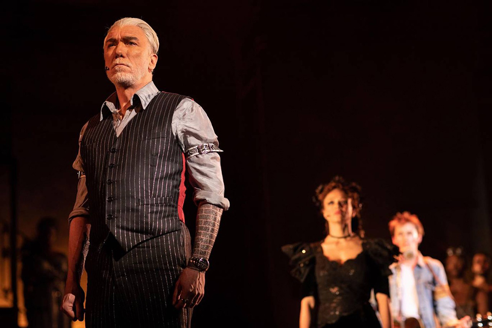 Patrick Page as Hades, Amber Gray as Persephone and Reeve Carney as Orpheus in Hadestown at the National Theatre - c Helen Maybanks