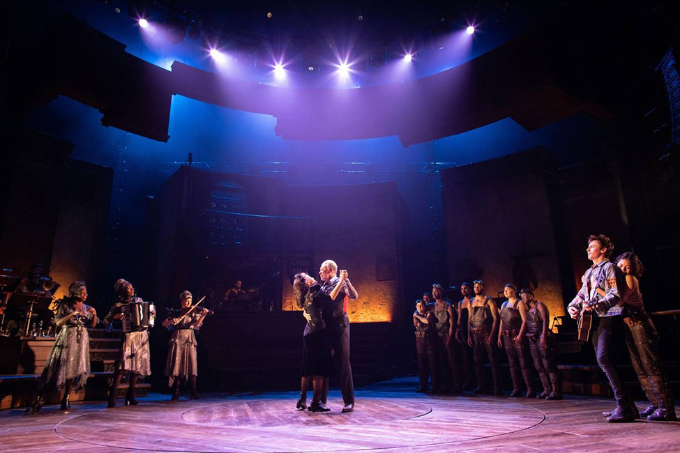 Patrick Page as Hades, Amber Gray as Persephone and the company of Hadestown at the National Theatre c Helen Maybanks